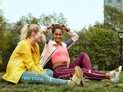 Girls exercising outside wearing Kari Traa