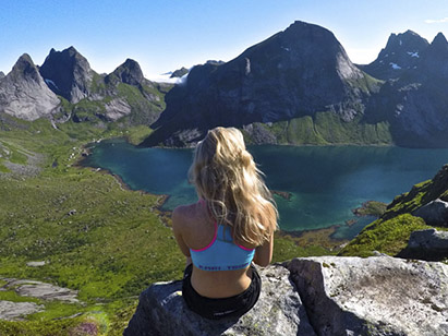 Girl sitting in the mountains enjoying the scenery