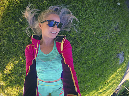 Girl laying on the grass wearing Kari Traa with sunglasses